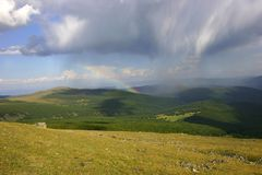 Mountain landscape with rainbow Royalty Free Stock Images