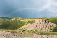 Mountain landscape with a rainbow. Hill, rainbow Stock Image