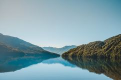 Mountain landscape reflected in the water royalty free stock image