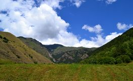Mountain landscape. Reserve Teberda, Karachay-Cherkessia Republic, Russia. Summer day in July, in the mountains of the Greater Caucasus. Heady clean air with Royalty Free Stock Photos