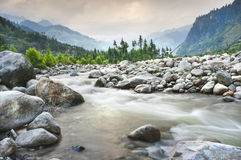 Mountain landscape with river and forest. A beautifull view of the Beas river from Manali among forested mountains Stock Images