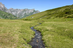 Mountain landscape of a river over Engelberg Stock Photo