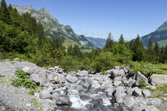 Mountain landscape of a river over Engelberg Royalty Free Stock Photography