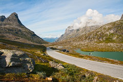 Mountain landscape with road and lake Stock Photo