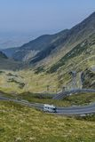 Mountain landscape with road and moving caravan travel trailer. Transfagarasan mountain road panorama . Stock Photography