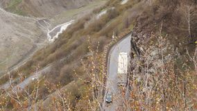Mountain landscape. The road passing in the mountains. Cars are driving along the road in the mountains. Road serpentine. In the Caucasus Mountains Cars traffic stock video