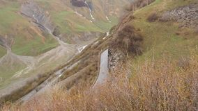 Mountain landscape. The road passing in the mountains. Cars are driving along the road in the mountains. Road serpentine. In the Caucasus Mountains Cars traffic stock video footage