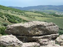 Mountain landscape: rock and valley Royalty Free Stock Photo