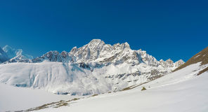 Mountain landscape with rocky ice peaks of Sagarmatha National Park. Severe Nepal winter. Stock Photos