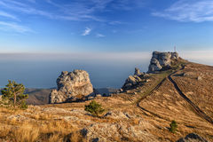 Mountain landscape scenic rock mountain Demerdzhi in Crimea in a. Beautiful sunsets in the autumn mountains. The cloudy sky above the sea. Mystical landscape Royalty Free Stock Photography