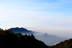 Mountain landscape. Mountain in the sea fog Royalty Free Stock Images