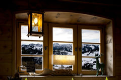 Mountain landscape seen from a window. Looking through a window to a landscape with snowed mointains Stock Photo
