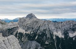 Mountain landscape of sheer ridge above valley. Royalty Free Stock Photography