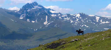 Mountain landscape and shepherd on horse. Stock Photography