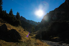 Mountain landscape with shining sun on the sky Stock Photo