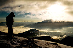 Mountain landscape with silhouette. Black man at the sunset Stock Images