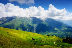 Mountain landscape with small wooden shack Royalty Free Stock Photos
