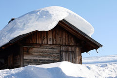 Mountain landscape, snow, chalet. A mountain landscape with a chalet in the snow Stock Image