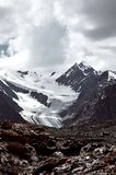 Mountain landscape with snow ice and glacier with a lot of clouds royalty free stock photo