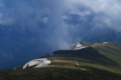 Snow patches at 2nd Phase in Gulmarg. Royalty Free Stock Images