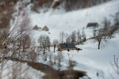 Mountain landscape in the snow, tilt shift. A mountain landscape in the snow, tilt shift royalty free stock images