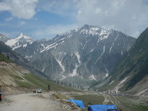 Mountain landscape in Sonamarg-3. A scene in a Kashmir a snow capped mountain and the vast valley with tents and travelers royalty free stock photo