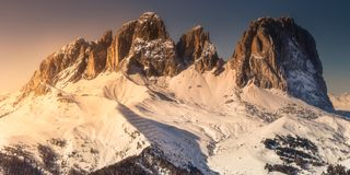 Mountain landscape and spine covered with snow. Marmolada, Dolomites during sunset, Italy Royalty Free Stock Photo