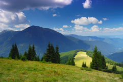 Mountain landscape in the summer. Landscape of summer mountains with the blue sky and clouds. The Ukrainian Carpathians stock photo