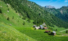 Mountain landscape in summer with characteristic barns in Trentino Alto Adige. View from Passo Rolle, Italian Dolomites, Trento, I Stock Photography