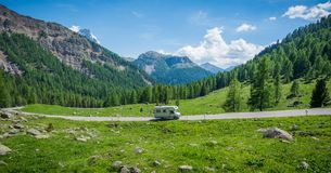 Mountain landscape in summer and the dark blue sky with clouds in Trentino Alto Adige. View from Passo Rolle, Italian Dolomites, T royalty free stock images