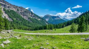 Mountain landscape in summer and the dark blue sky with clouds in Trentino Alto Adige. View from Passo Rolle, Italian Dolomites, T stock photography
