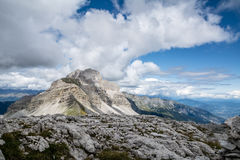 Mountain landscape in summer taken at high quote. Mountain landscape taken in the Alps in a clear summer day. No snow. Sky is dark blue with some clouds adding Stock Image