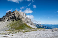 Mountain landscape in summer taken at high quote. View of a mountain (top at about 3.000m) in the Alps taken in a clear summer day. No snow. Sky is dark blue Royalty Free Stock Photos