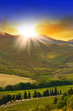 Mountain landscape with sun and  clouds Royalty Free Stock Images