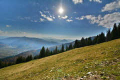 Mountain landscape with sun. Stock Photo