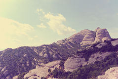 Mountain landscape on a sunny day; filtered, retro style Stock Images