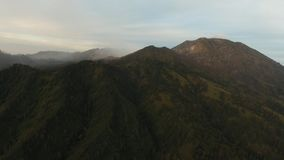 Mountain landscape with sunset. Jawa island, Indonesia. Beautiful sunset in the mountains on Jawa island, Indonesia. Aerial view of mountains landscape under Stock Photo