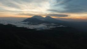 Mountain landscape with sunset. Jawa island, Indonesia. Beautiful sunset in the mountains on Jawa island, Indonesia. Aerial view of mountains landscape under Stock Photos