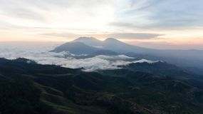 Mountain landscape with sunset. Jawa island, Indonesia. Beautiful sunset in the mountains on Jawa island, Indonesia. Aerial view of mountains landscape under Stock Image