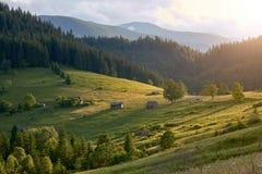 Mountain landscape, sunset warm sun illuminates the hills and the valley royalty free stock image