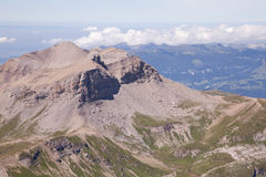 Mountain Landscape. In the Swiss Alps with a rock resembling a human head. View from Mt. Schilthorn Royalty Free Stock Images