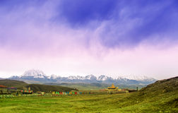 Mountain landscape with tibetan monastery by Tagong grassland in China stock images