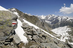 Mountain landscape with tourist trail. Tourist trail in the mountain with snow Stock Photos