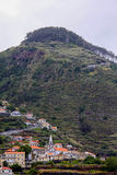 Mountain landscape. The town at the foot of the montain. Island Madeira stock photography