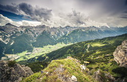Mountain landscape with trail, green meadow and forest. Austrian Alps stock photos
