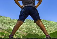 Mountain landscape between two legs of woman stock photo