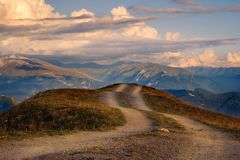 Mountain landscape view with curvy road and colorful sunset clouds, Svaneti, Georgia Stock Image