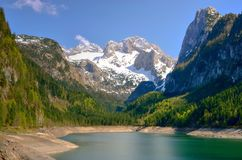 Mountain landscape. View of Hoher Dachstein and Mitterspitz from the lake Vorderer Gosausee in Austrian Alps Stock Image