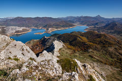 Mountain landscape with view of the village, Riano Reservoir and Espigüete Peak, Leon, Spain. Stock Photo