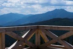Mountain landscape viewed from a wooden balcony. In the Rarau Mountains, Romania, Eastern Europe in summer Royalty Free Stock Photos